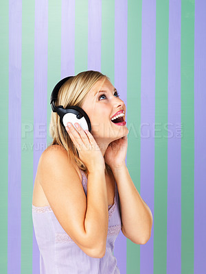 Buy stock photo Pretty woman looking up with headphones on