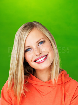 Buy stock photo Happy blue eyed woman smiling on green background