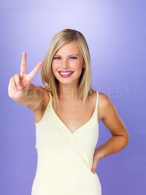 Buy stock photo Portrait of happy blond woman giving peace sign
