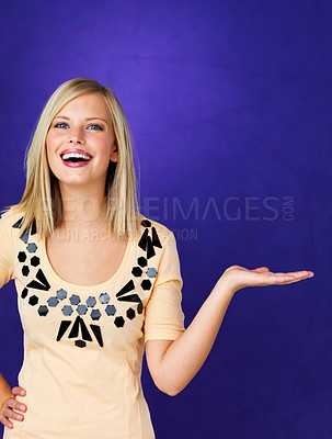 Buy stock photo Portrait of attractive young woman holding invisible product