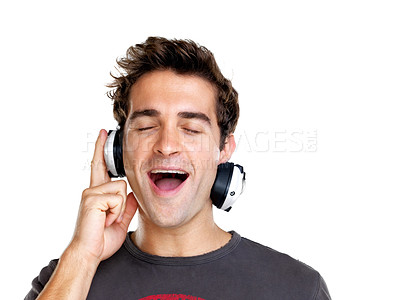 Buy stock photo Portrait of a happy young man listening to music with headphone against white background