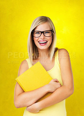 Buy stock photo Attractive woman smiling while holding book