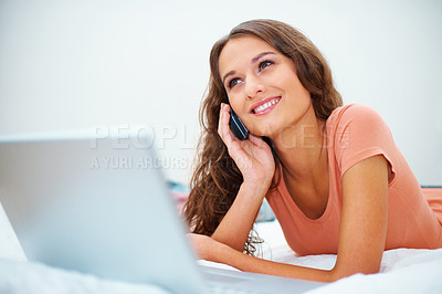 Buy stock photo Happy girl daydreaming while on the phone in bed with laptop