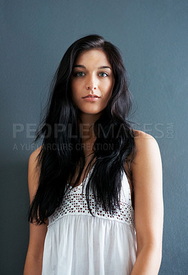 Buy stock photo Portrait of a cute young lady looking at you with an attitude against grey background