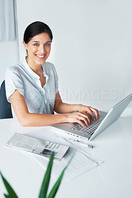 Buy stock photo Portrait of a beautiful young business woman working on laptop in the office