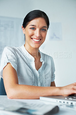 Buy stock photo Portrait of a smart young business woman using a laptop in the office