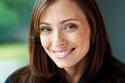 Buy stock photo Closeup portrait of a happy young woman looking at you with a smile