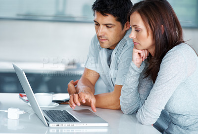 Buy stock photo Portrait of a cute young couple working together on laptop - Indoor