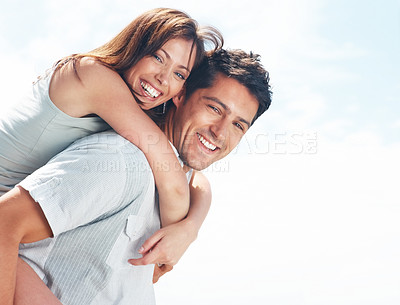 Buy stock photo Portrait of a happy young girl enjoying piggyback ride on her boyfriend back - Outdoor