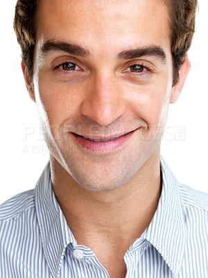 Buy stock photo Closeup portrait of a handsome young guy smiling against white background