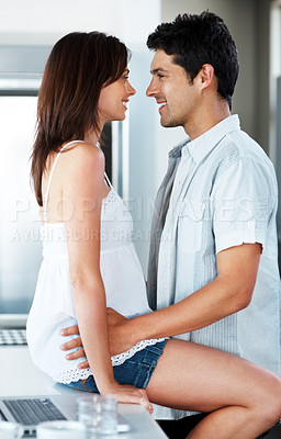 Buy stock photo Portrait of a romantic young couple looking at each other - Indoor