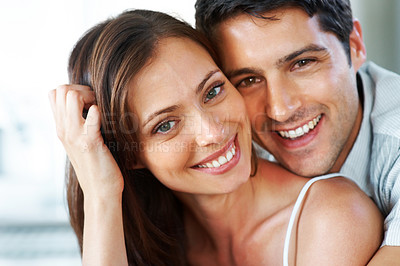 Buy stock photo Closeup portrait of a beautiful young couple smiling together