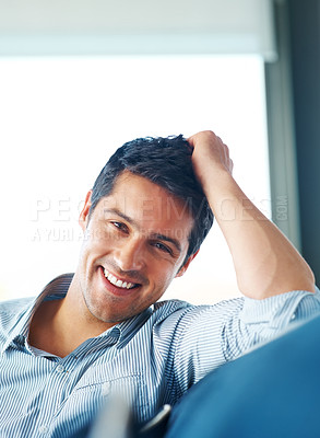 Buy stock photo Portrait of a happy young guy sitting on sofa at home - Indoor