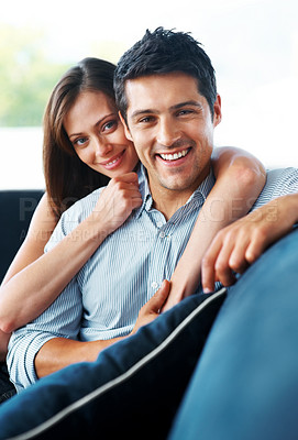 Buy stock photo Portrait of a lovely young couple sitting together on couch at home - Indoor