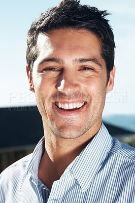 Buy stock photo Portrait of a smart young guy looking at you with a smile