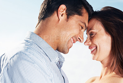 Buy stock photo Closeup portrait of a happy young couple with their heads together - Outdoor