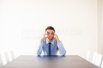 Buy stock photo Depressed business man with bad headache