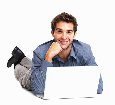 Buy stock photo Happy junior executive lying in front of laptop on white background