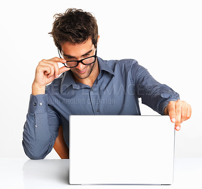 Buy stock photo Happy business man in glasses looking at laptop on white background