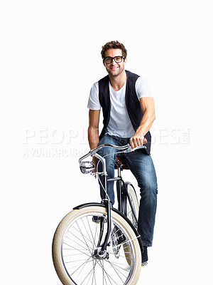 Buy stock photo A handsome man riding his retro bike against a white background