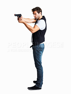 Buy stock photo Studio shot of a young man with a handgun isolated on white