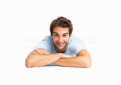Buy stock photo Man lying on floor with arms crossed