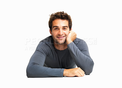 Buy stock photo Attentive man lying on the floor listening