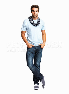 Buy stock photo Stylish young man standing with hands in pockets on white background