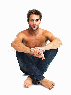 Buy stock photo Sexy young man sitting in jeans on white background