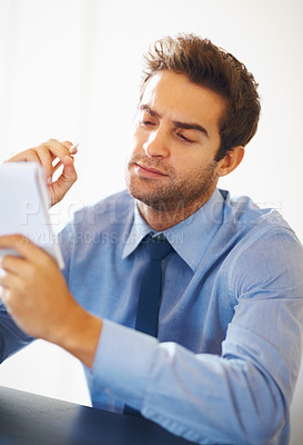 Buy stock photo Portrait of young executive looking at the notepad