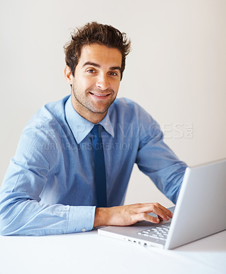 Buy stock photo Portrait of handsome business man working with laptop