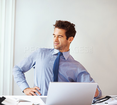 Buy stock photo Portrait of young executive holding back with pain