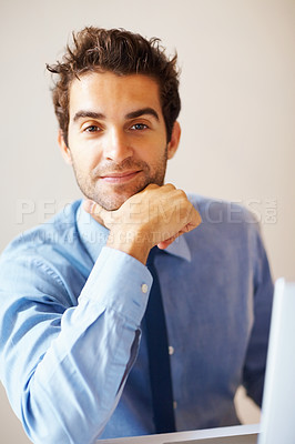 Buy stock photo Executive sitting and resting chin on hand