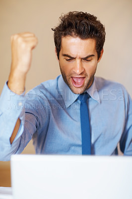Buy stock photo Excited junior executive looking at laptop