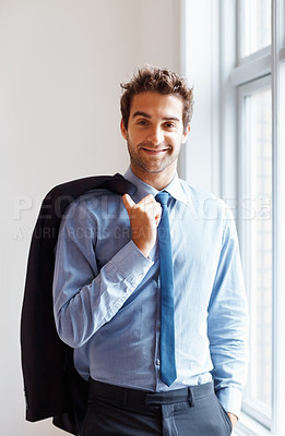 Buy stock photo View of happy executive standing next to window with jacket over shoulder