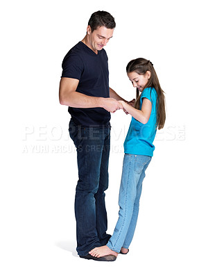 Buy stock photo Portrait of a little girl standing on her father feet while dancing over white background