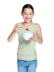 Cute young girl eating bowl fruit on white