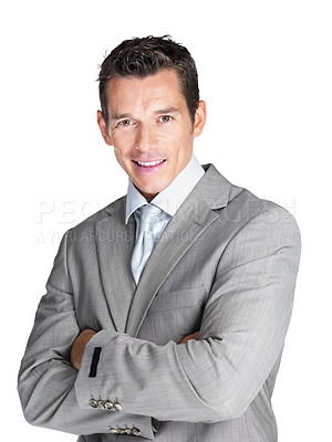 Buy stock photo Portrait of a confident young male entrepreneur standing with folded hand against white background
