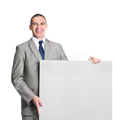 Buy stock photo Portrait of a smiling young male business executive holding a blank billboard against white background