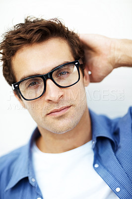 Buy stock photo Closeup portrait of thoughtful young man in glasses against white background
