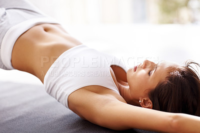 Buy stock photo Closeup portrait of health conscious woman doing yoga exercise on mat at home