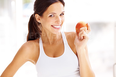 Buy stock photo Portrait of healthy young female holding a fresh ripe apple