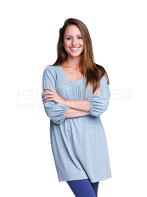 Buy stock photo Portrait of a happy young woman smiling with her hand folded against white background