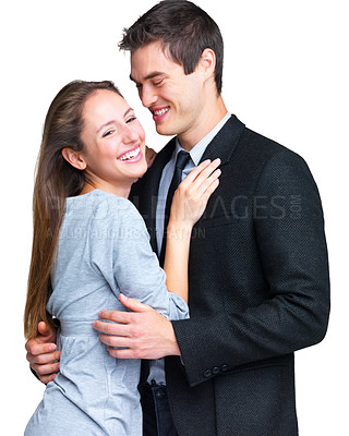 Buy stock photo Portrait of a happy young couple hugging each other against white background