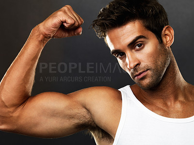 Buy stock photo Closeup portrait of muscular man flexing his biceps on black background