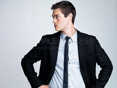 Buy stock photo Portrait of a thoughtful young business man looking at copyspace against grey background
