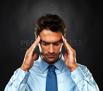 Buy stock photo Closeup of business man suffering from headache and massaging his temples on black background