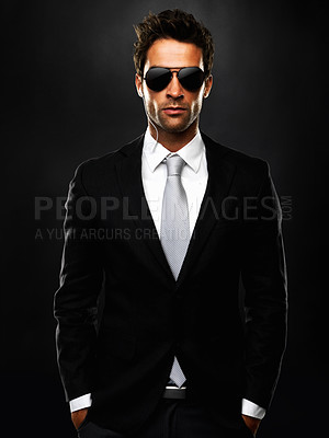 Buy stock photo Portrait of smart bodyguard standing on black background