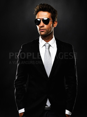 Buy stock photo Secret service agent looking away on black background