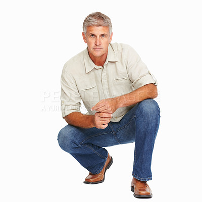 Buy stock photo Studio shot of a mature man giving crouching against a white background